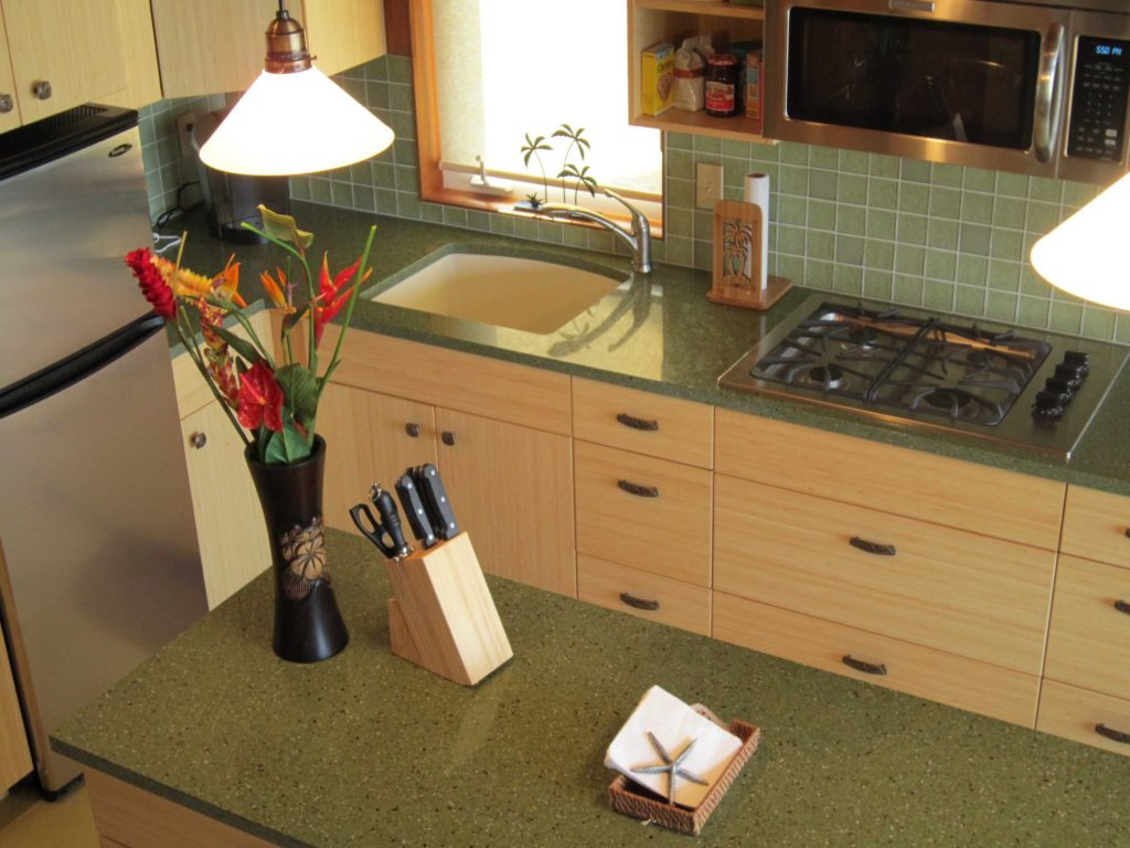Custom Kitchen features green countertops and a custom island.