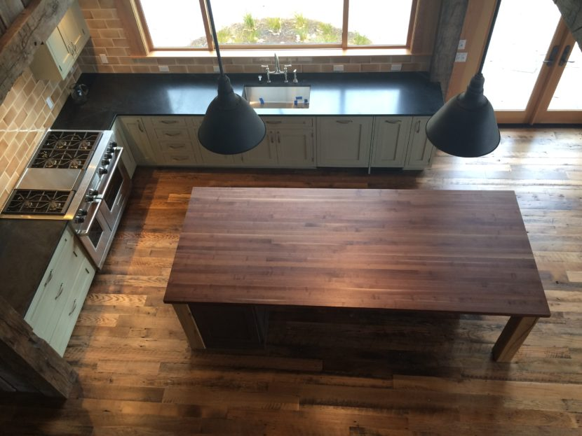 Top down view of a finished custom kitchen with a wooden center island